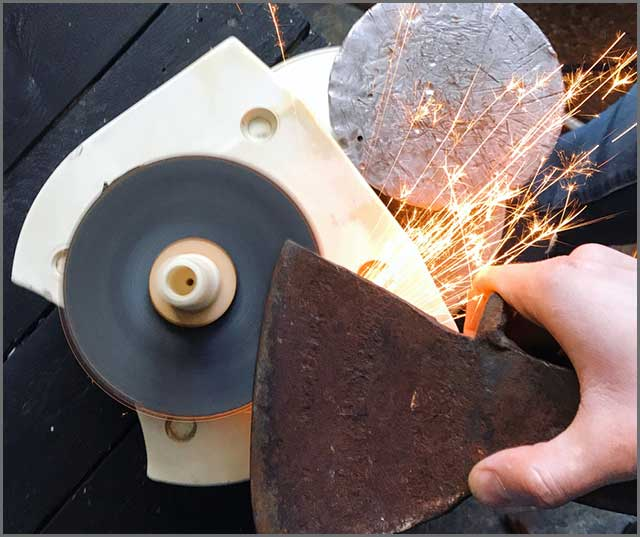 a grinder working on a blade cut out