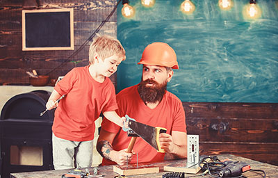 playing with toy saw, learning use tools with dad
