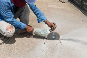 Shows worker cutting stone