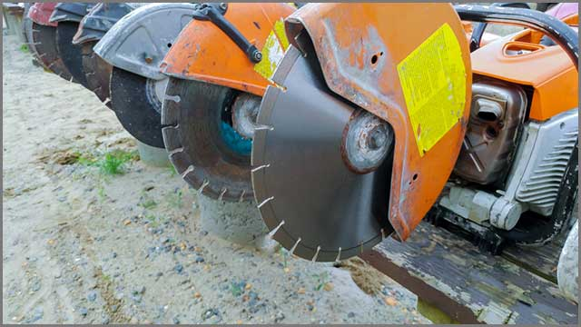 A picture of numerous concrete saws arranged side by side