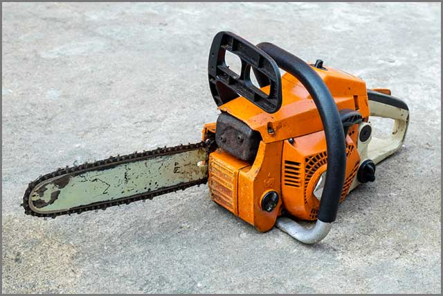 A picture of a chainsaw placed on the floor