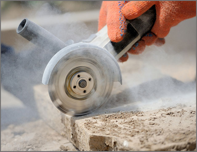 Worker finishing a stone cut