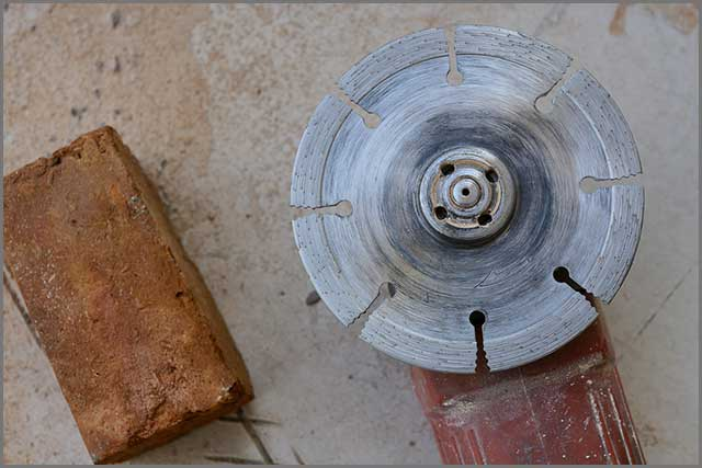 Image showing a segmented saw blade being used to cut brick.