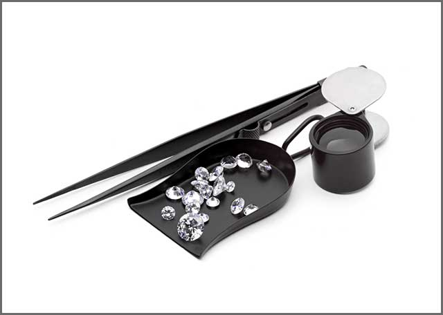 Various kinds of jeweler tools and some pieces of the diamond