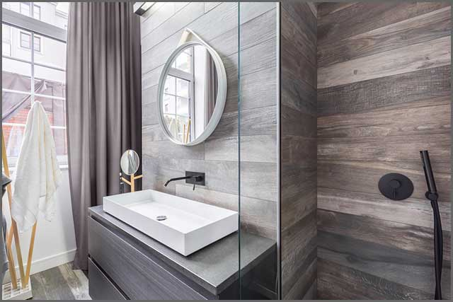 A walk-in bathroom with a perfectly laid tile