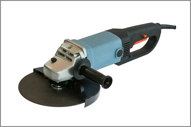 A picture of a compact blue grinder in a studio