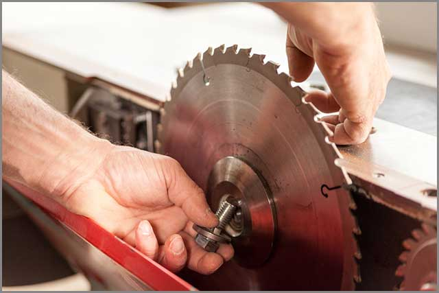 A woodworker changing the saw blade for his circular saw