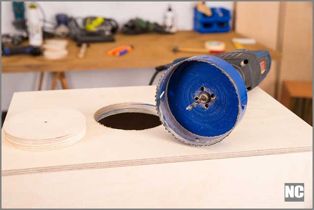 Hole saw resting on a surface after use