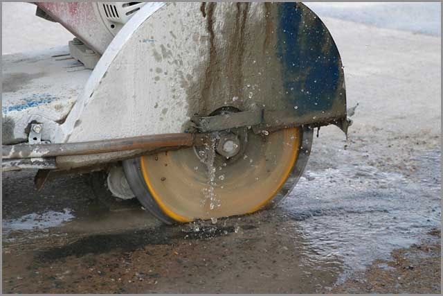 Cutting concrete with water used to decrease dust spread