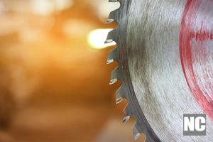 Close up blade of circular saw on blurred background