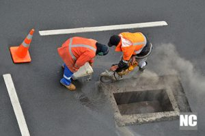 People working with road diamond saws