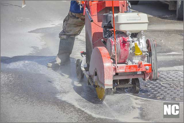 Portion of an asphalt road cleaned of large and small rocks.Asphalt Cutting Blade