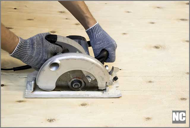 A man working with a circular saw