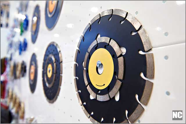 Discs for a circular saw on a wall in the store