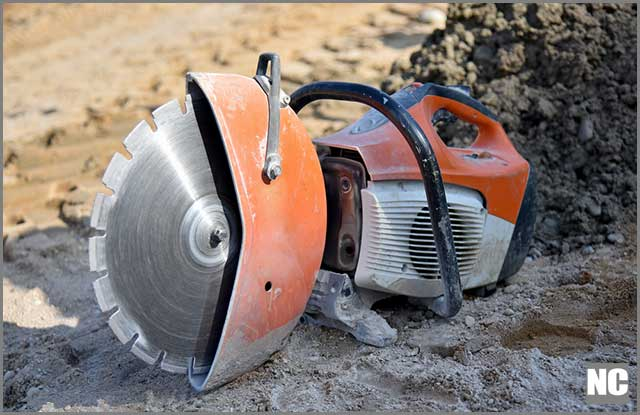 A circular saw blade laying on the ground