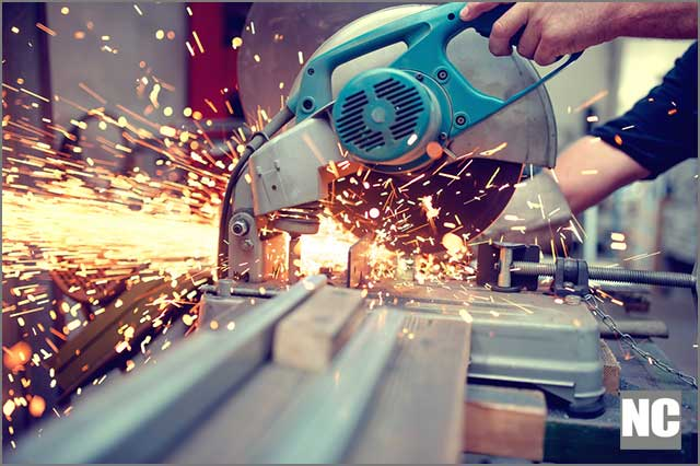 (Industrial engineer engaged in cutting metal and steel with sharp TCT saw blades)