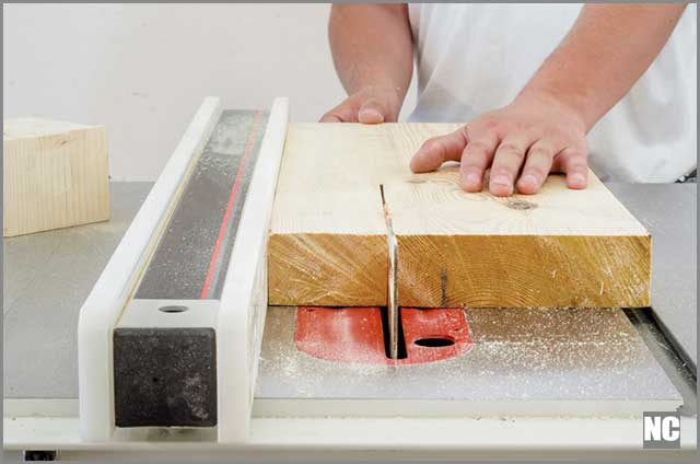 Rip-cutting a wood on a table saw.