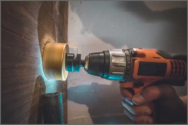 Hand power drill in operation with the core bit