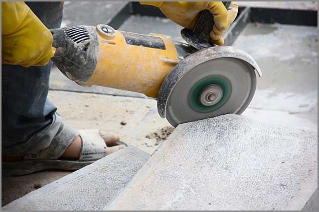 A worker cutting stone