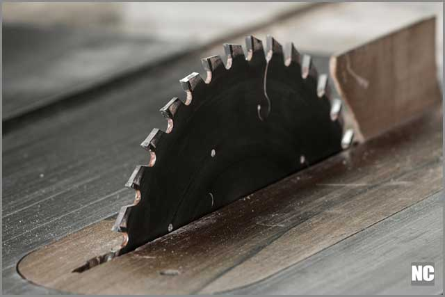 A newly replaced table saw a cross-cuts blade.