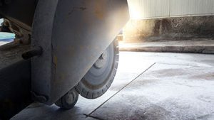 Cutting concrete floor with a diamond saw blade