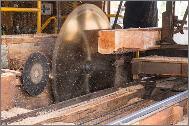 A large spinning saw blade