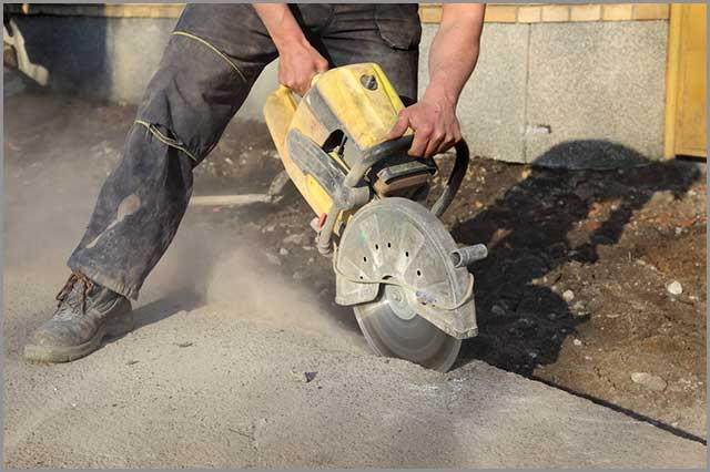 Dry-cutting operation using the hand-held concrete cutting saw.