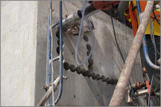 Drilling holes in concrete using diamond core drill bits