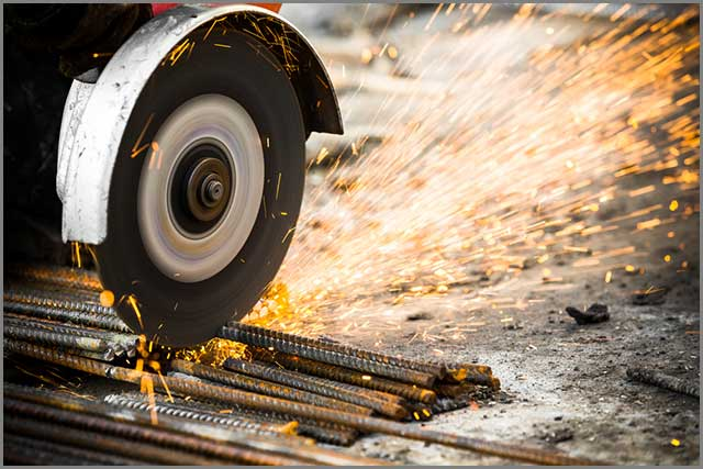 A steel grinding wheel cutting metal rods