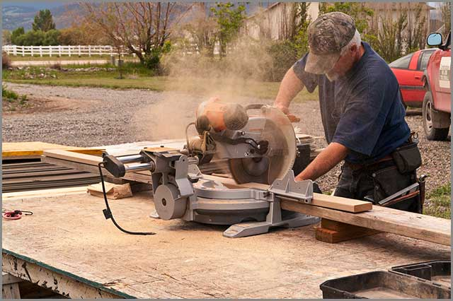 A construction worker cutting board with a sliding miter saw