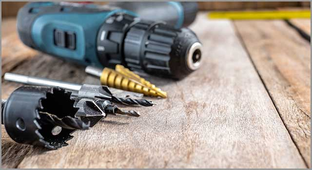 A Hole Saw and a Set of Drill Bits