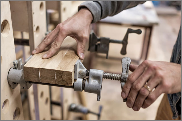 Using clamps to connect wooden timbers