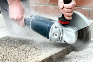 A professional using an angle grinder