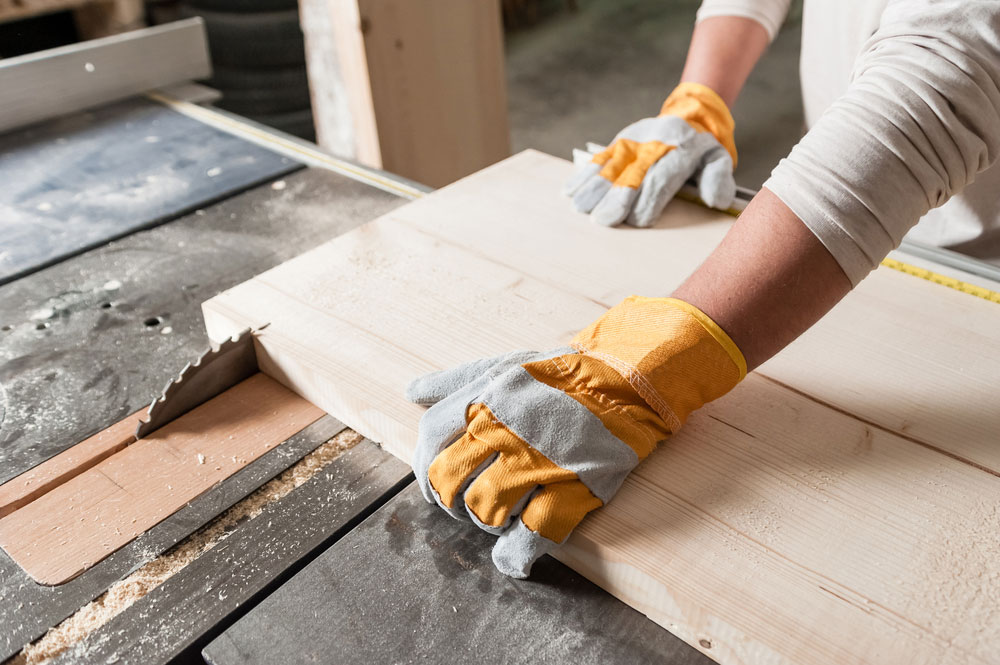 An operator is using a blunt circular saw blade to <a class=