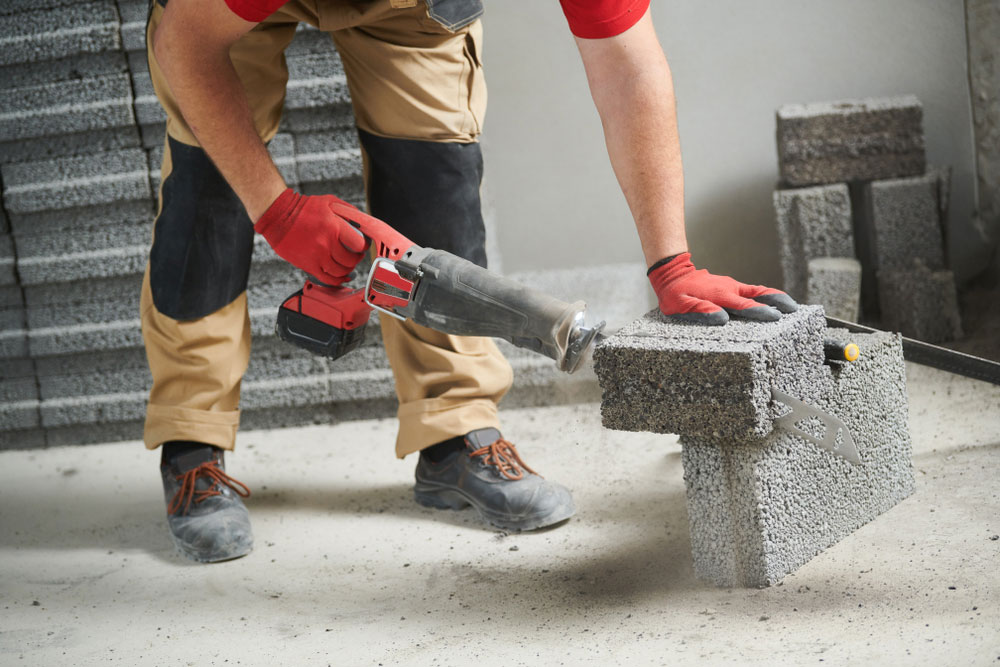 Concrete cutting with a cordless reciprocating saw.