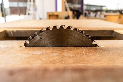 A table saw cutting wood